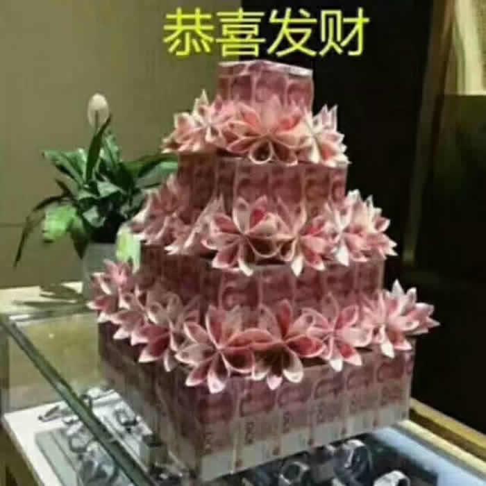 三八节礼物                                                                                          鲜花网:4层人民币生日蛋糕